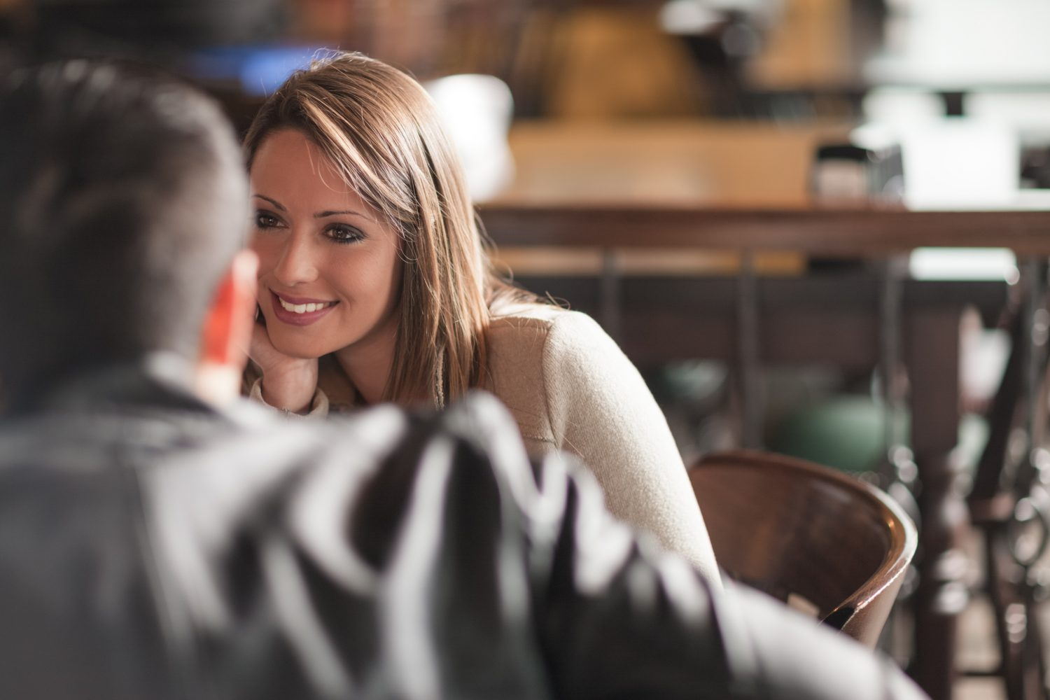 Young couple talking in restaurant