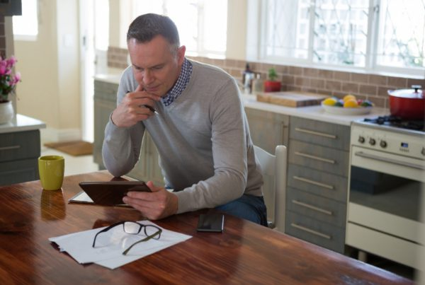 Man review finances on tablet