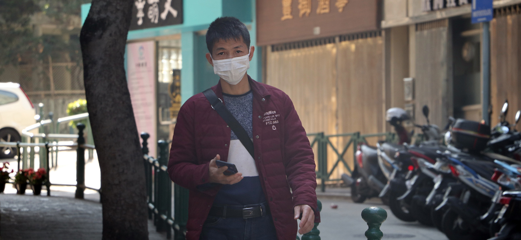 Photo of Chinese Man in surgical mask